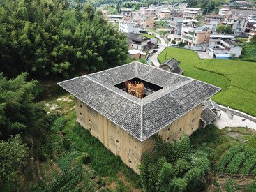 The alternative renovation strategy: A Tower in the inner courtyard of Tulou collecting each floor through a spiral stairway