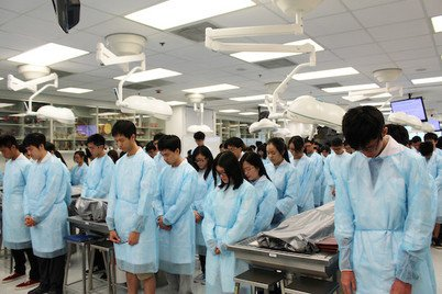 Medical students observing a moment of silence in the Respect Ceremony
