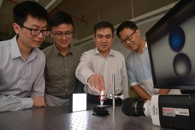 Professor Liqiu Wang (third from left) and his team demonstrate droplet manipulation using liquid-repellent materials