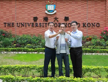 Dr Tony Shien-Ping Feng (left) and Dr Wen-Di Li (right) of the Department of Mechanical Engineering, and Mr Kent Chung, Flectrode's investor, holding a piece of prototype metal-mesh transparent electrode manufactured through the process developed at HKU
