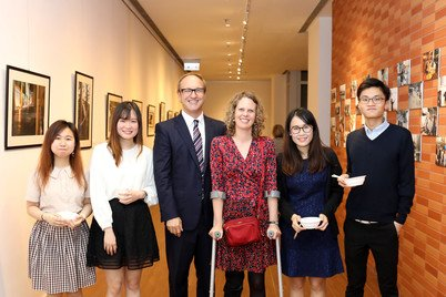 Professor J. Charles Schencking and Dr Janet Borland (third and fourth from left) at the photo exhibition held in April 2017 about the Mitsubishi Young Leaders Tour of Japan, a field trip initiated by Dr Borland for students to explore post-3.11 earthquake and tsunami reconstruction initiatives