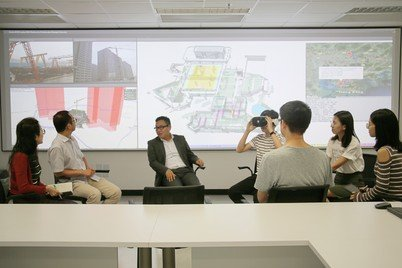 Dr Wilson Lu (third from left) and his team discussing the digital construction platform